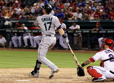 Justin Smoak smacks his second 3-run homer of the game for his first career multi-HR game. (AP Photo/Tony Gutierrez)