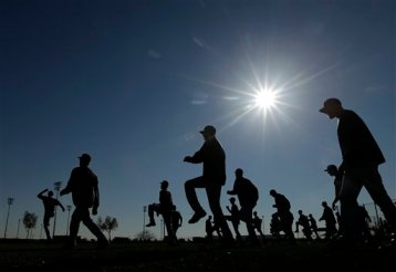 Mariners players going through stretching drills o the first day of 2013 Spring Training. (Associated Press)