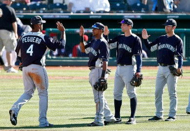Player of the Game Carlos Peguero (2 home runs) gives high fives after the win.  (AP Photo/Ross D. Franklin)