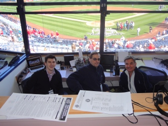 Aaron Goldsmith, Kevin Cremin and Rick Rizzs in the Mariners broadcast booth.