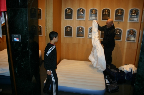 Raul Ibañez and his son RJ make up a bed in the Plaque Room at the Baseball Hall of Fame for an Extra Innings Overnight sleepover.