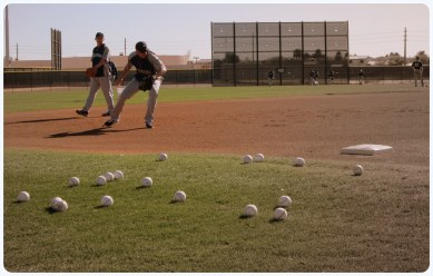 Alex Liddi and Kyle Seager field grounders at third base during today's workout.