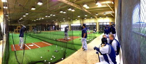A panoramic view of Mariners practice inside the batting cages.
