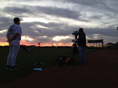 Manager Eric Wedge answers questions from MLB.com as the sun rises in Peoria.