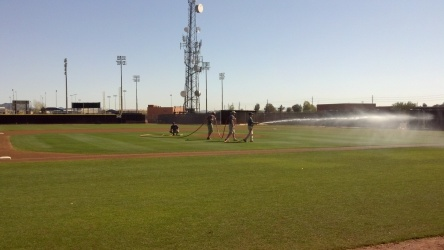 The grounds crew gets the field ready for the sim game.