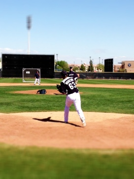 Jesus Montero works with Jeff Datz on throwing to second base.