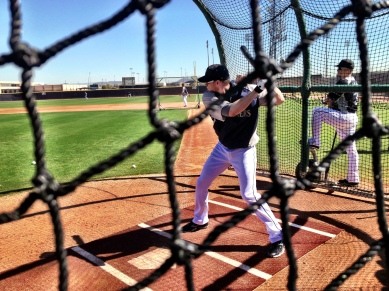 Michael Saunders takes his cuts in the batting cage.
