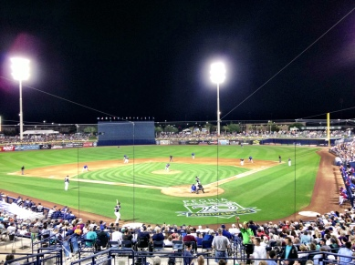 Peoria Stadium lit up for a night game.