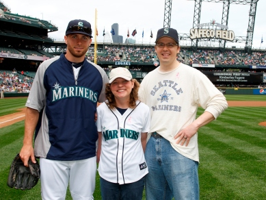 Honorary Bat Girl Kimberly Fugere, her husband Ross, and Dustin Ackley pose for a pregame photo.