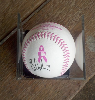 Game-used baseballs with pink stitching will be auctioned on MLB.com to raise money for cancer research.