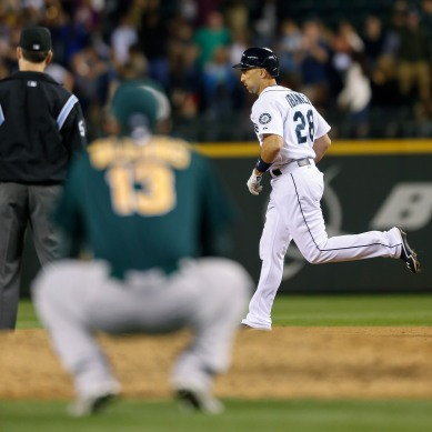 Raul Ibanez rounds the bases after hitting a game-tying 3-run home run off Jerry Blevins.