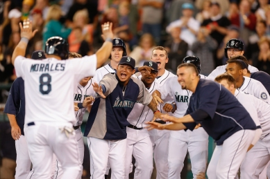 Kendrys Morales is mobbed by his teammates after hitting a walk-off HR.