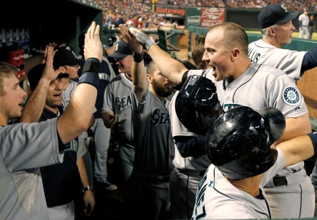 Kyle Seager is congratulated by teammates after hitting a home run last night.