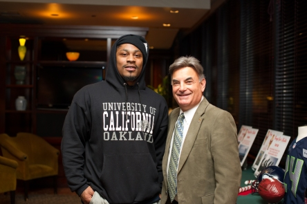 Seattle Seahawks running back Marshawn Lynch and Toys for Kids host Rick RIzzs.
