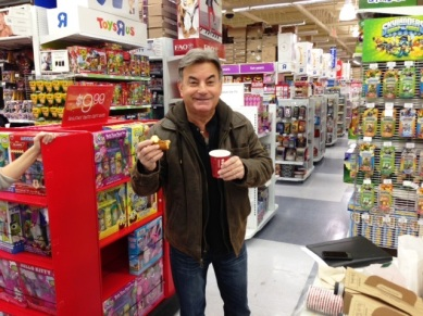 Rick Rizzs fuels up with coffee and a donut before the annual Toys for Kids shopping spree.