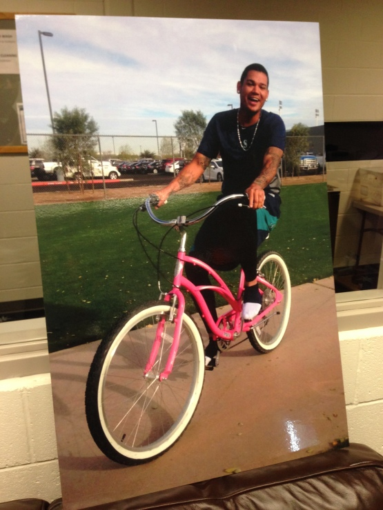 Felix Hernandez has fun with Chris DeWitt's pink bike.