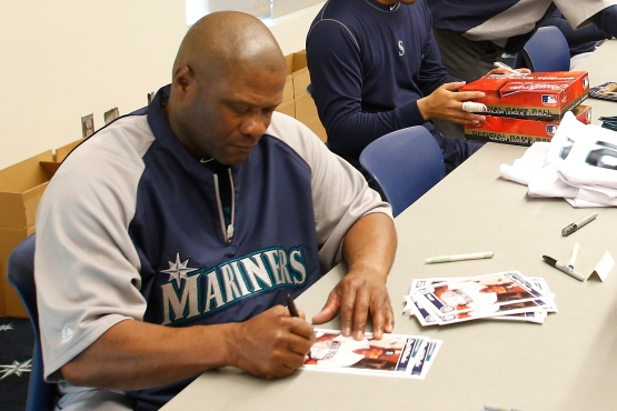 Manager Lloyd McClendon signs for worthy causes.