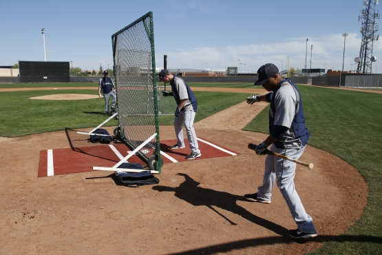 Robinson Cano offers Justin Smoak some tips on the Net Drill.