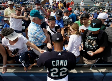 Robinson Cano signs for fans prior to the game vs. the Indians.