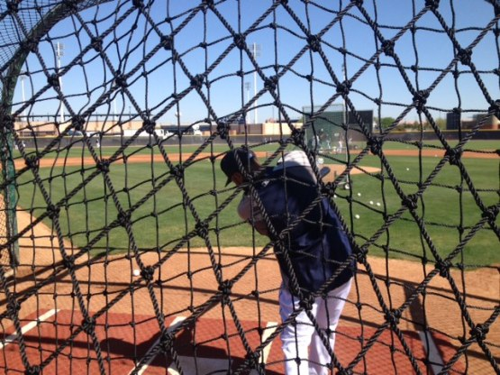 Robinson Cano takes some swings in the cage before the game.