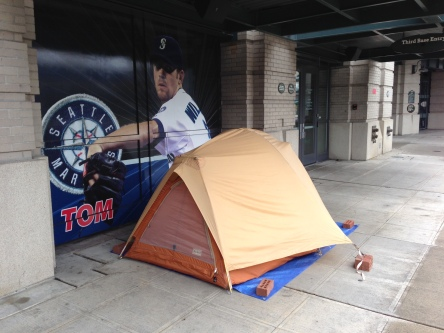 A tent on the sidewalk next to Safeco Field is home to Greg Holbron for a couple of nights each spring.