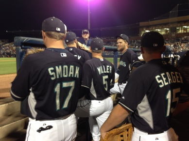 Justin Smoak, Kyle Seager and Brad Miller prepare to take the field.