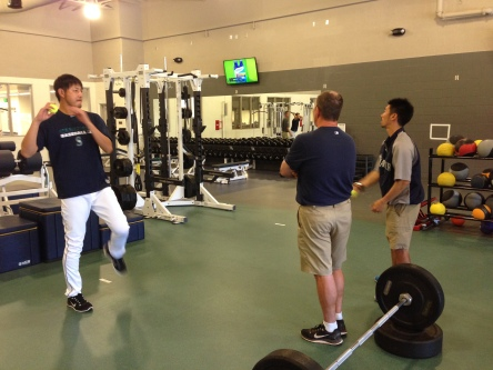 Hisashi Iwakuma working out under the watchful eye of Head Athletic Trainer Rick Griffin.