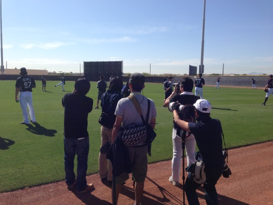 Media gathers to watch Hisashi Iwakuma play catch.
