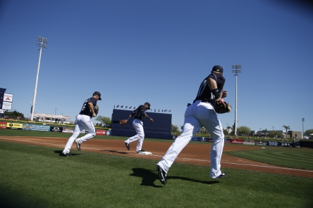 The Mariners take the field for the Cactus League game vs. the Rockies.