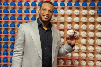 Signing for the ball wall at the MLB Fan Cave.