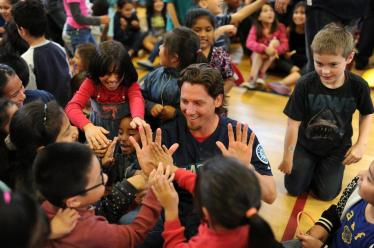Danny Farquhar gets high fives from students at Hazel Valley Elementary School in Burien.
