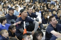 – Stefen Romero, Taijuan Walker, Mike Zunino and Brad Miller sit with students from Hilltop Elementary School as they watch a highlight video during the D.R.E.A.M. Team assembly.