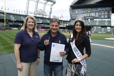 Seafair president Beth Knox and Miss Seafair Rio Barber flank Sir Rick Rizzs, Seafair's newly-knighted Royal Sage of Safeco Field and Prince of Play-by-Play.""