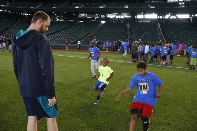 Pitcher Charlie Furbush leads kids through sprints during a PLAY Campaign event at Safeco Field.