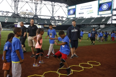 Catcher Mike Zunino helps kids navigate an agility trial at a PLAY Campaign event at Safeco Field.