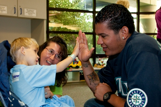 Felix Hernandez visits young patients at Seattle Children's Hospital as part of the Holland America Line Get Well Tour.