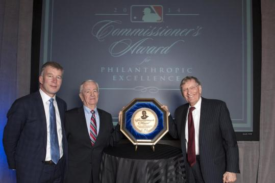 Mariners President Kevin Mather and Chair Emeritus John Ellis accept the CAPE Award from MLB Commissioner Bud Selig.