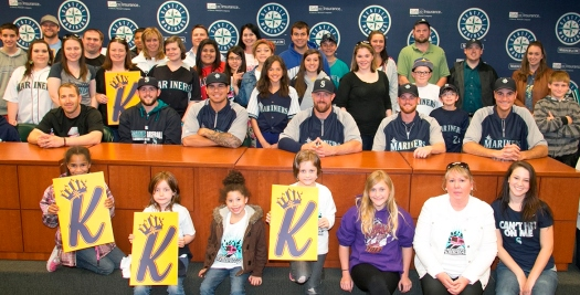 Chris Young, right, is joined by teammates and volunteers at the MLBPA Buses for Baseball event that gave a group of underserved kids a day at Safeco Field.