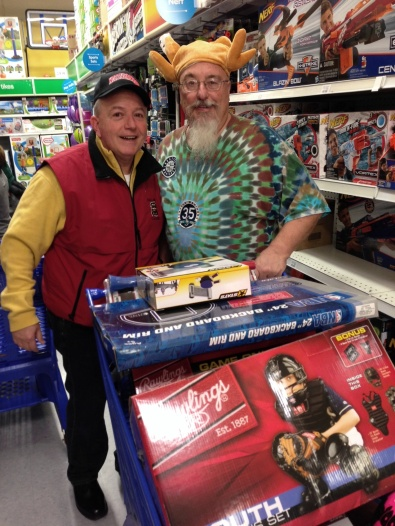 RBI Club members Bob Simeone and Steve Smith shop for Toys For Kids gifts.