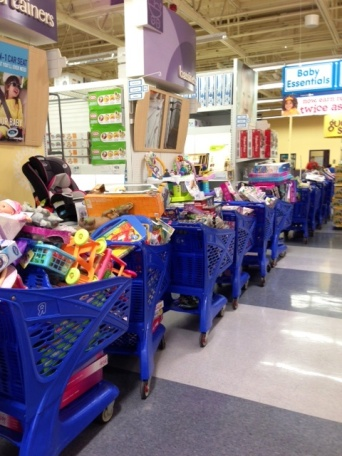 Dozens of shopping carts at Bellevue's Toys R Us piled high with gifts for Toys For Kids.
