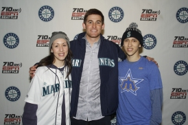 Brad Miller taking his photo with some fans.