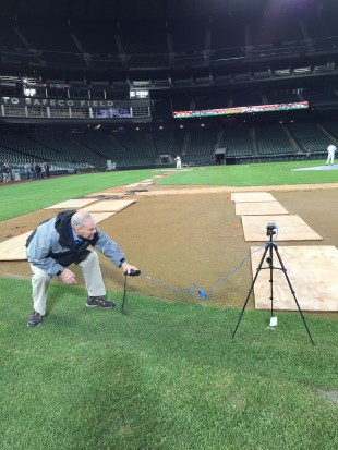 MLB lighting expert Mike Owens measuring light at various points around the field.