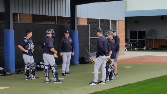 Dan Wilson works with the catchers during workouts.