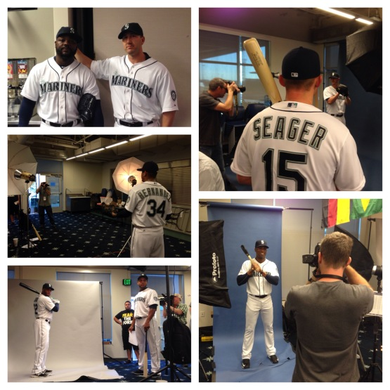 All Mariners in camp when through a line of photographers.