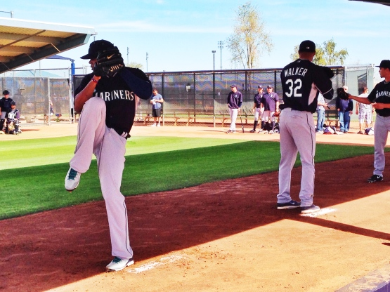 Roenis Elias (left) and Taijuan Walker (right) completed their first bullpens of the spring.