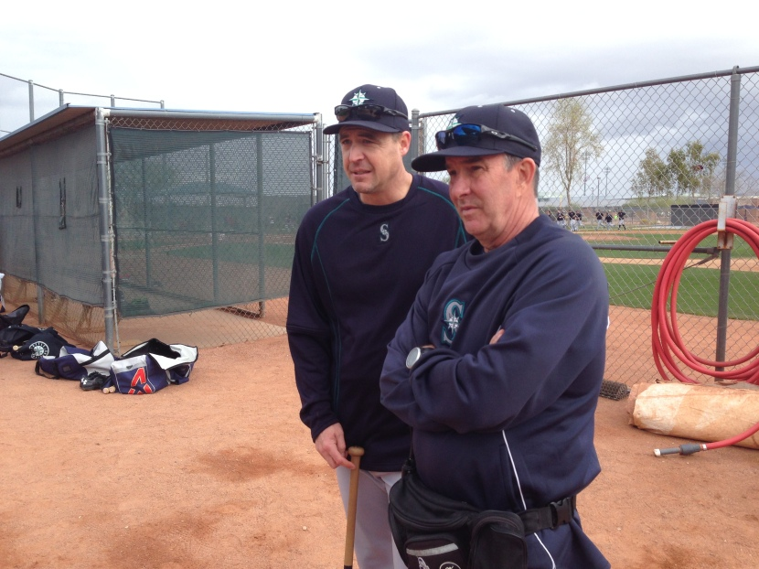 Mariners roving catching instructor Dan Wilson chats with Head Trainer Rick Griffin.
