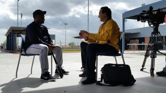 Chris Egan checks in with Manager Lloyd McClendon.