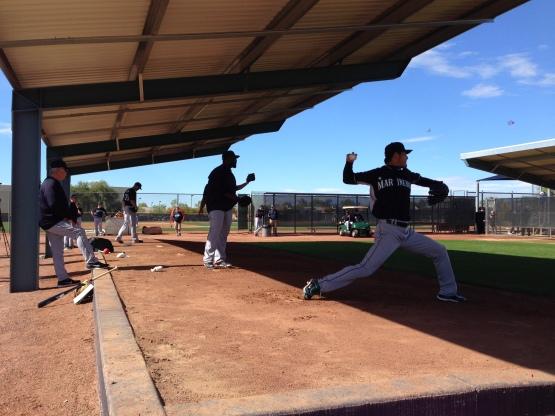 Hisashi Iwakuma throwing a bullpen in the shadows.