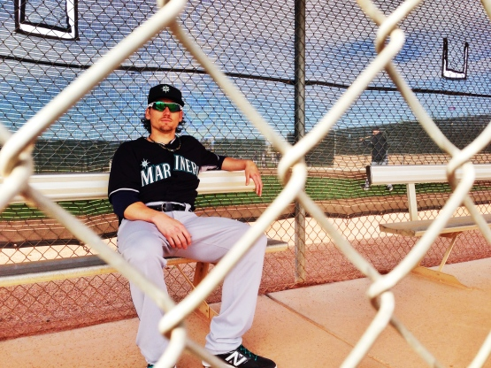 Danny Farquhar relaxes before getting on the field this morning.