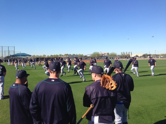 The Mariners stretch on the field as the first day of workouts begins.
